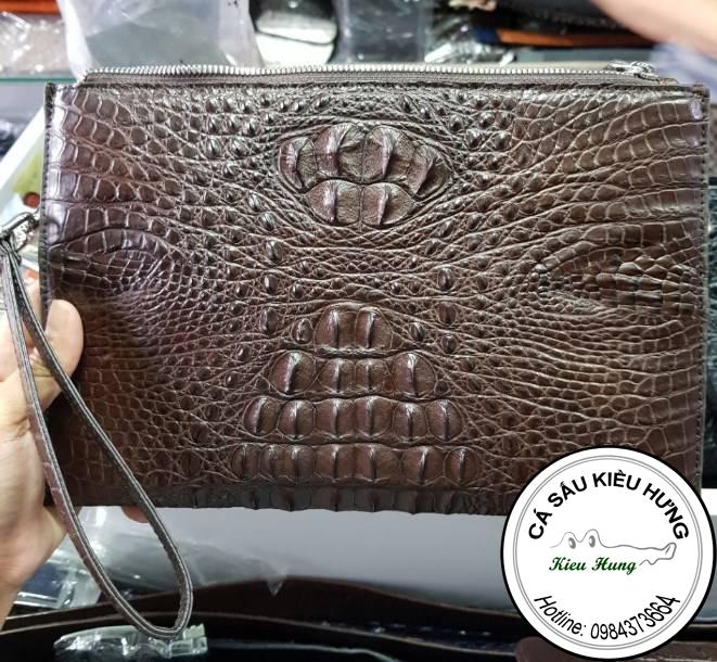 Túi đựng điện thoại da cá sấu giá bao nhiêu?